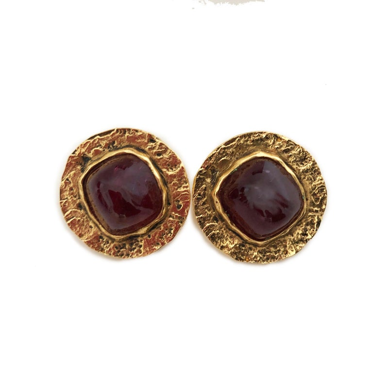 Chanel Red Glass Earrings with Hammered Gold Setting, made by Goossens for Chanel in the 70s.  Clip Style. Acquired from the estate of a Palm Beach retiree who once worked for Chanel in Paris.  Preowned/vintage with signs of use/wear: