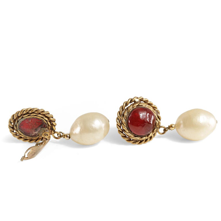 Chanel Red Gripoix and Pearl Clip on Earrings- Excellent Condition   Baroque pearls dangle from dark red gripoix stone with gold braided surround.  Clip on style.  1980's.