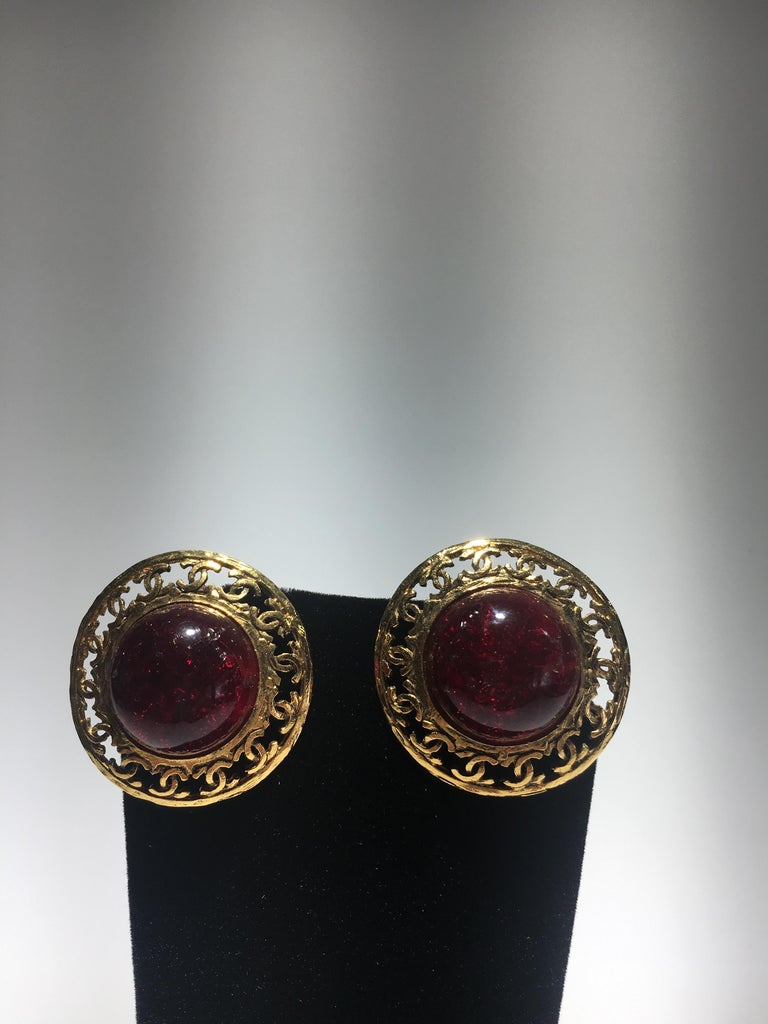 Chanel red poured glass, gripoix, and gold cc metal clip on earrings. They come with original box.  Stones have internal inclusions to appear to be natural stones.