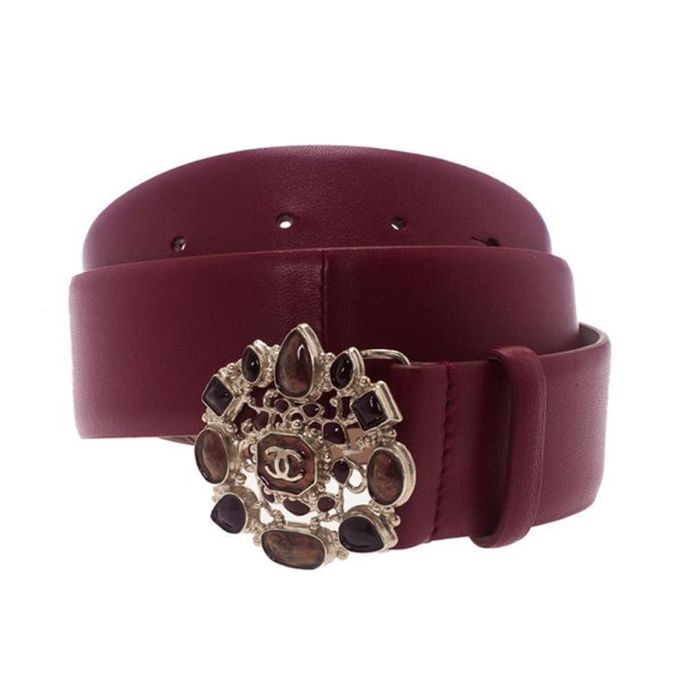 Add the perfect pop of color to your look with this Chanel Belt. Made from supple red colored leather, it features a gold-tone and resin buckle with the brands logo embellished in the middle.  Includes: Original Dustbag  The Luxury Closet is an