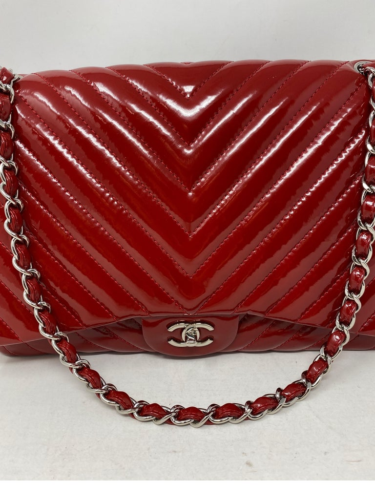 Chanel Red Chevron Patent Maxi Bag. Double flap bag. Silver hardware. Good condition. Clean interior. Includes authenticity card. Beautiful cherry red color bag. Guaranteed authentic.
