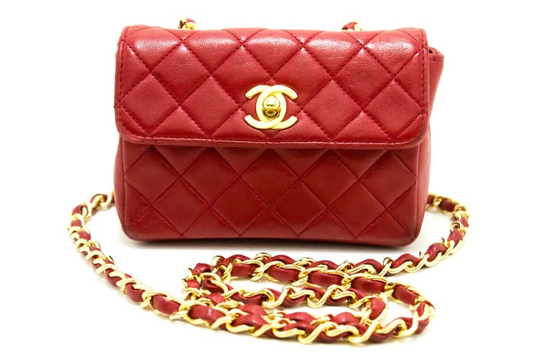6751b323c842 An authentic CHANEL Red Mini Very Small Chain Shoulder Bag Crossbody  Quilted. The color is