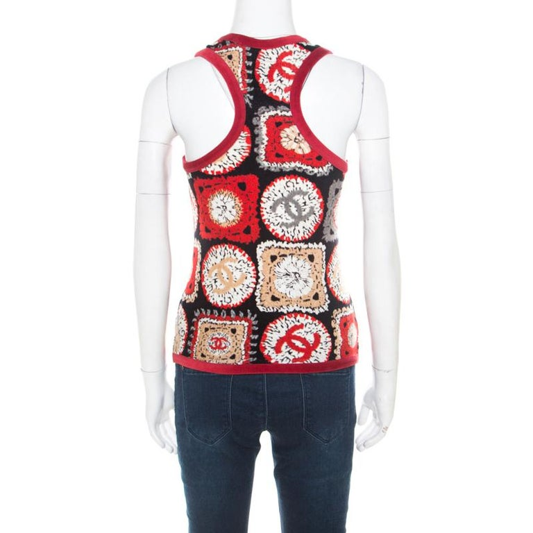 Chanel brings to you the best of the modern trends. Add a unique flair to your wardrobe with this printed red top. Made from blended fabric, this velvet top with a racer back is perfect for your casual fashion.  Includes: The Luxury Closet