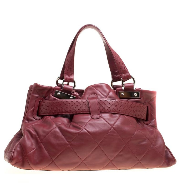 This tote by Chanel is gorgeous! Crafted from red leather, it features the signature quilted pattern and will carry your everyday essentials in style. It flaunts a strap detailing at the front with a logo engraved silver-tone lock. The bottom is