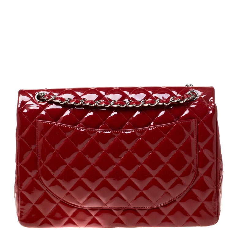 Chanel's Flap bags are the most iconic handbags. The classic double flap bag is crafted from patent leather and features the iconic quilted pattern. It has a chain and leather woven strap along with a CC twist lock closure in silver-tone. The flap