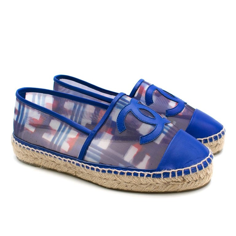 Chanel Red, White, and Blue Mesh Espadrilles  - Leather toe, lining, and Chanel logo - Boosted twine platform - Faint plaid pattern on mesh - Leather insole  Please note, these items are pre-owned and may show signs of being stored even when unworn