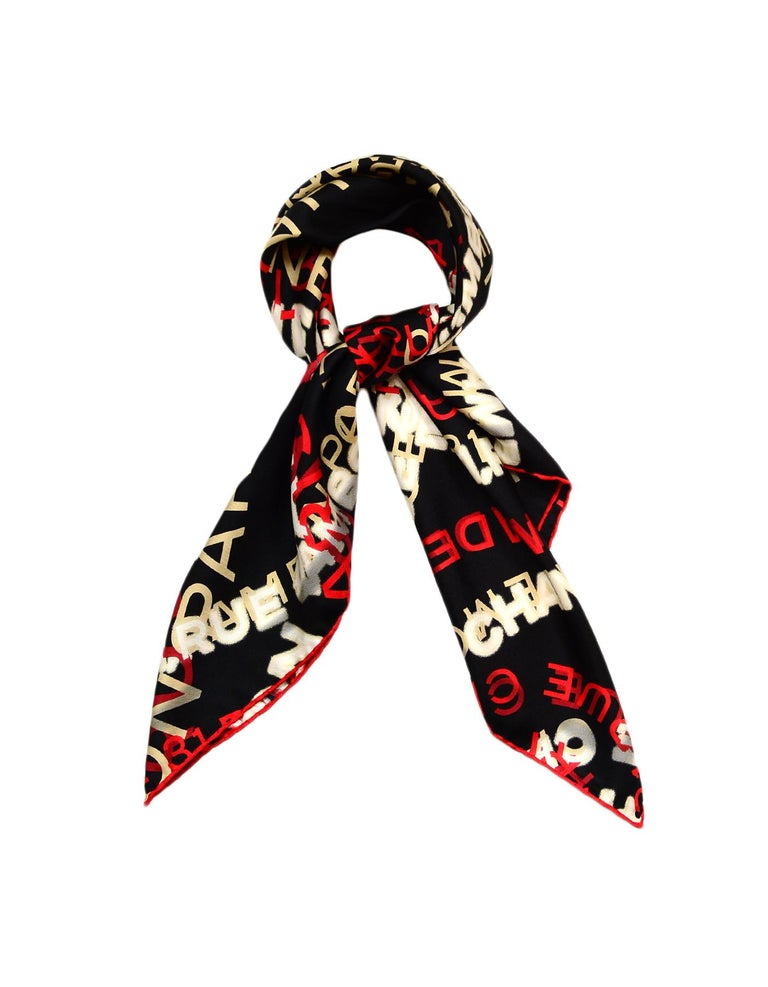 Chanel Red & White w/ Black Background Silk Scarf  Made In: Italy Color: Red, White, Black Materials: 100% Silk Overall Condition: Excellent pre-owned condition  Measurements:  34