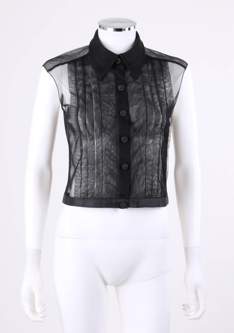 Chanel Resort 2002 black sheer button up extended shoulder blouse. Designed by Karl Lagerfeld. Black sheer nylon mesh. Shirt collar. Six center front black rhinestone embellished button closures. Eight knife pleat detail at front. Front and back