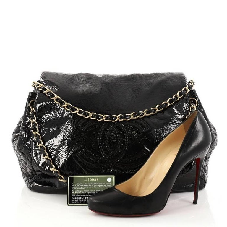 dae89b66e687 This authentic Chanel Rock and Chain Flap Bag Patent Vinyl Large boasts a  large stature perfect