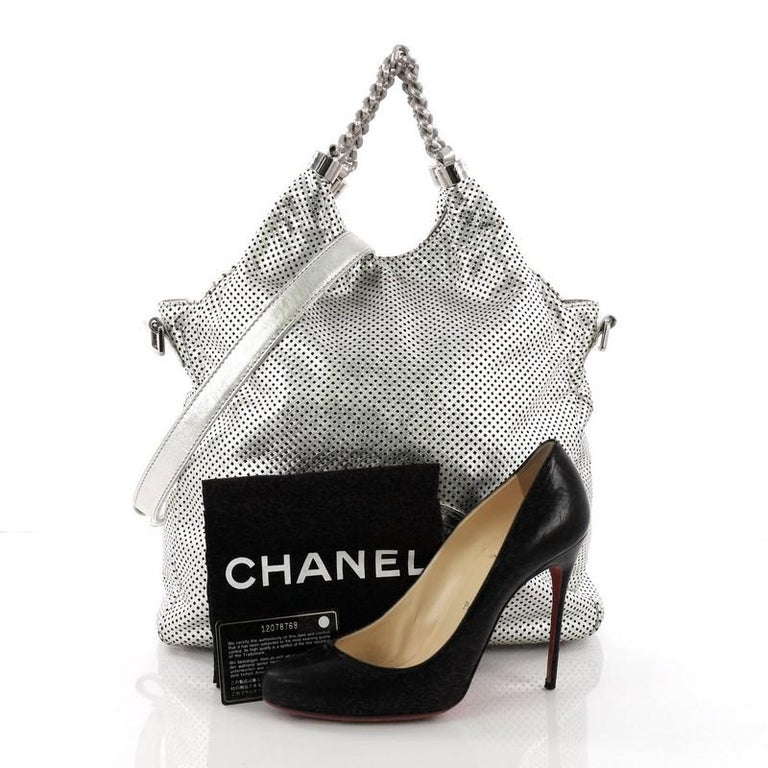 74e3d69e7217 This Chanel Rodeo Drive Hobo Perforated Leather Large, crafted in metallic  silver perforated leather,