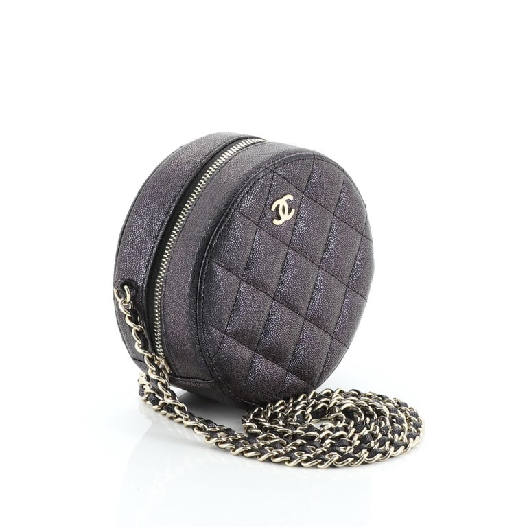 This Chanel Round Clutch with Chain Quilted Caviar Mini, crafted from green, purple and multicolor quilted caviar leather, features woven-in leather chain strap and gold-tone hardware. Its zip closure opens to a black fabric interior with slip