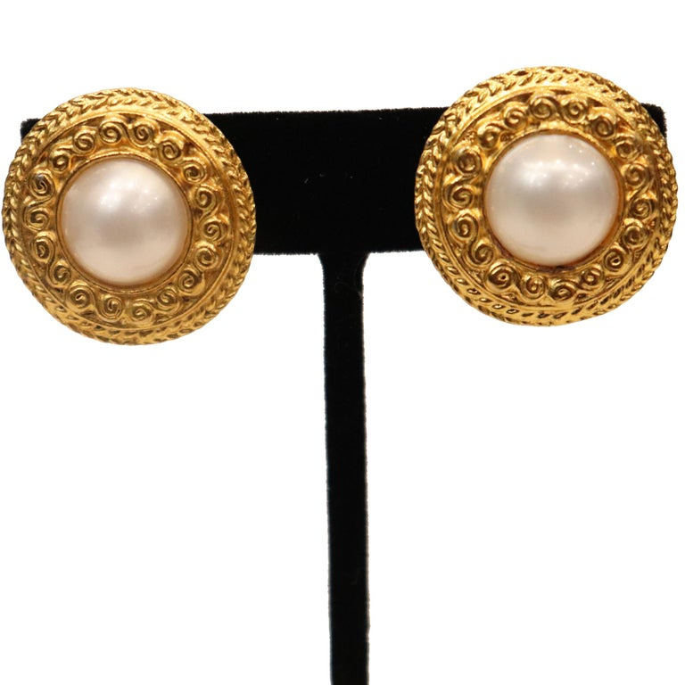 Round Cut Chanel Round Faux Pearl Gold-tone Plated Metal Clip on Earrings Circa 1980s For Sale