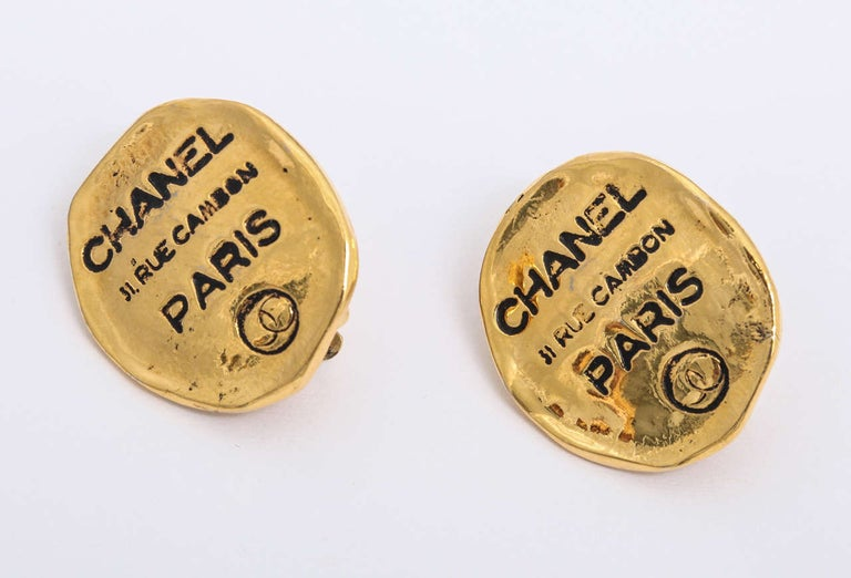 Chanel clip-on earrings with iconic Rue Cambon address.