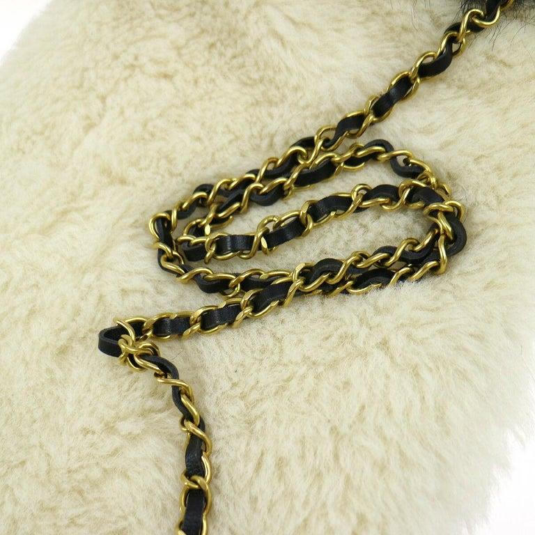 Chanel Runway Black White Fur Gold Logo Evening Muffler Shoulder Hand Mitt Bag In Good Condition For Sale In Chicago, IL