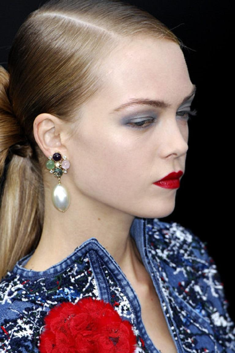 CHANEL runway dangling earrings (clip-on) featuring multicolor resin cabochons, CC logo, clear crystals and a large faux pearl drop in a pale gold toned setting.  As seen on the CHANEL Spring/Summer Ready-to-Wear 2008 runway.  Embossed CHANEL 08 P
