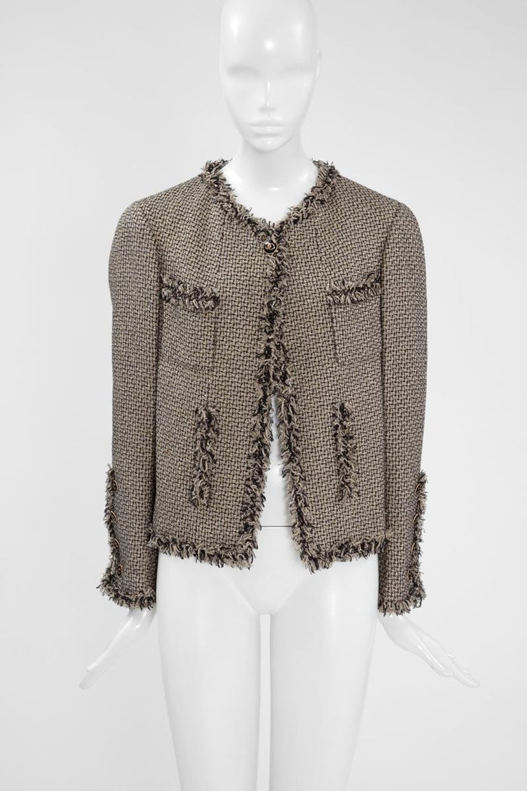 From the 2007 Spring-Summer Chanel ready-to-wear collection, this jacket appeared in the look number 41 of the fashion show (see picture 3). Cut from traditional woven tweed, the fabric is enriched with gold Lurex thread providing a luxurious feel.