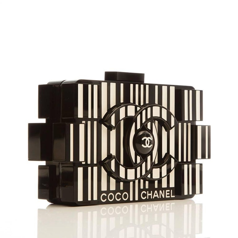 Chanel's playful lego clutch gets a barcode treatment. This rare and collectable clutch bag is formed of plexiglass patterned with a striking Op-art graphic on one side and it's done so in Coco Chanel's favourite two colours: ivory and black.