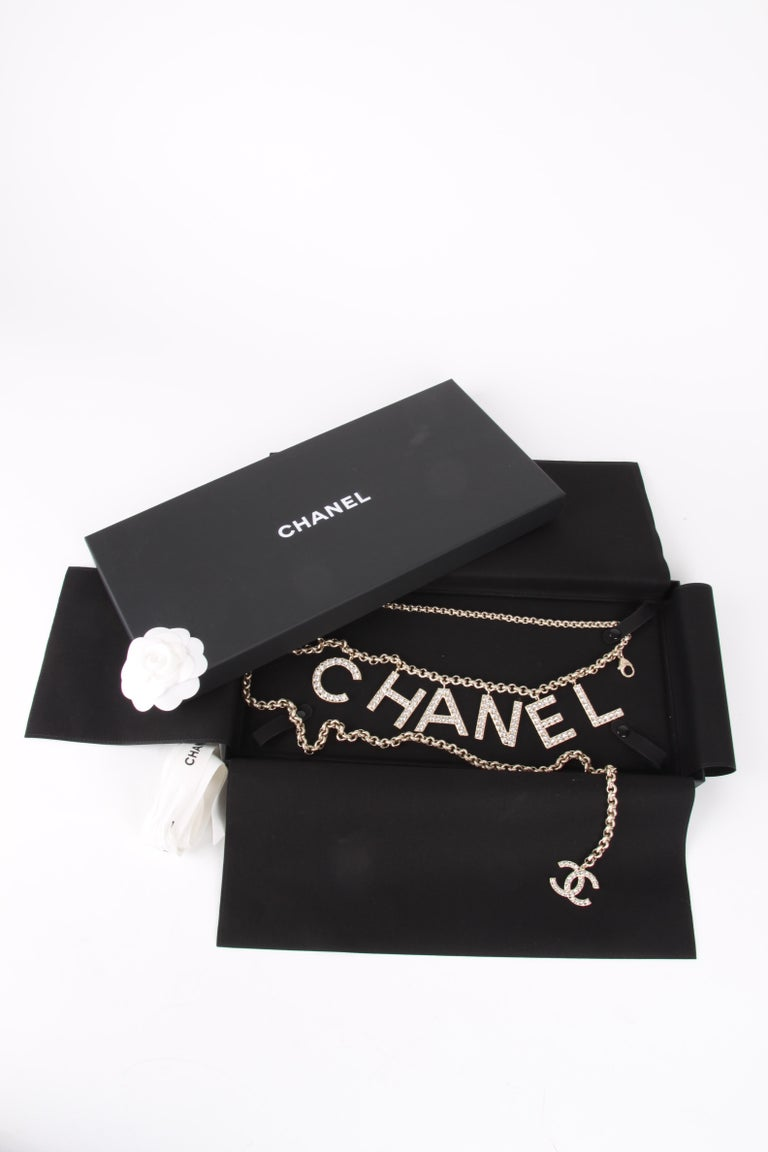 Chanel Chain Logo Belt from the Sping/Summer Collection Of 2019.  SOLD OUT WORLD WIDE.  This stylish belt is a gold tone chain with crystal CHANEL letters and a Chanel CC at the end with the timeless quality and style only from Chanel! Most sought
