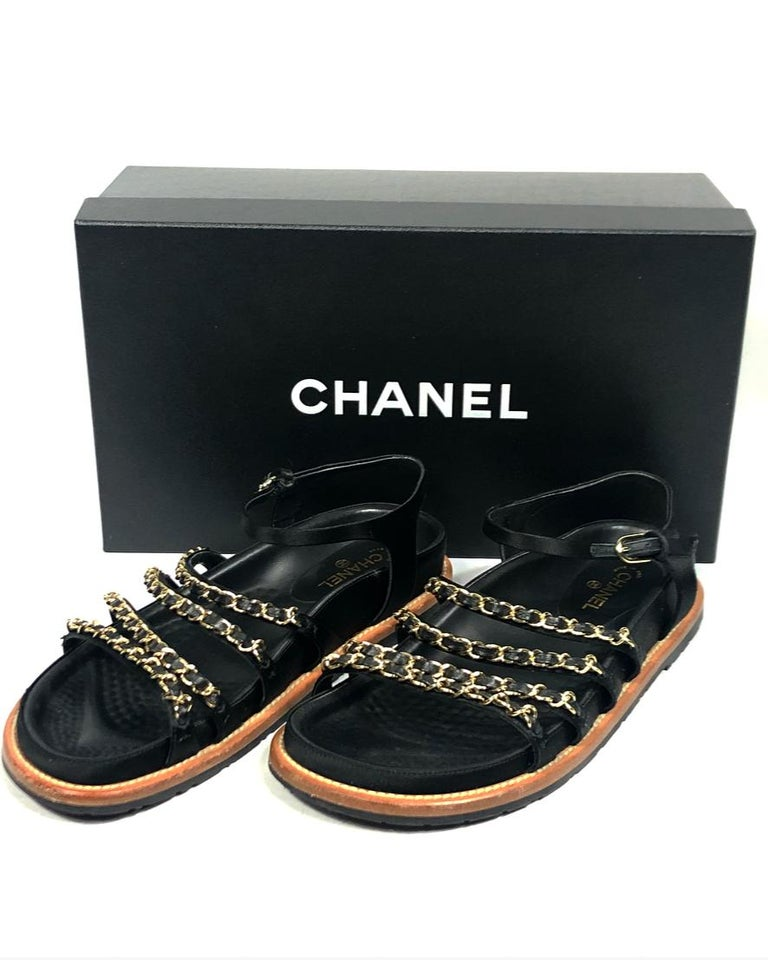 CHANEL Satin Lambskin Flat Sandals w/ 10mm Chain- Link Strap Size 38  Product details: From the 2015 spring collection  Size 38 Black satin and metallic gold-tone leather Chanel sandals  10mm chain-link accents at uppers, stacked heels  Buckle