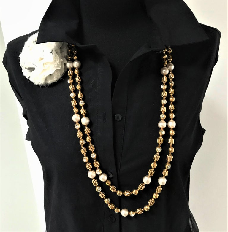 A great very long vintage Chanel Sautoir made by Robert Goossens Paris with crem colored faux pearls (made by Gripoix), gold balls filled with large diamante rhinestones and other gold elements, made by R. Goossens. The sautoir can be worn twice or