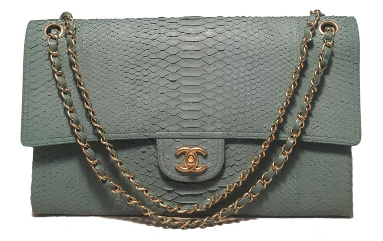 Chanel Sea Foam Python Snakeskin Classic Flap in excellent condition. Pale sea foam green python snakeskin exterior trimmed with matte gold hardware. Woven chain and leather shoulder strap can be worn short or long to suit any style. Front CC logo