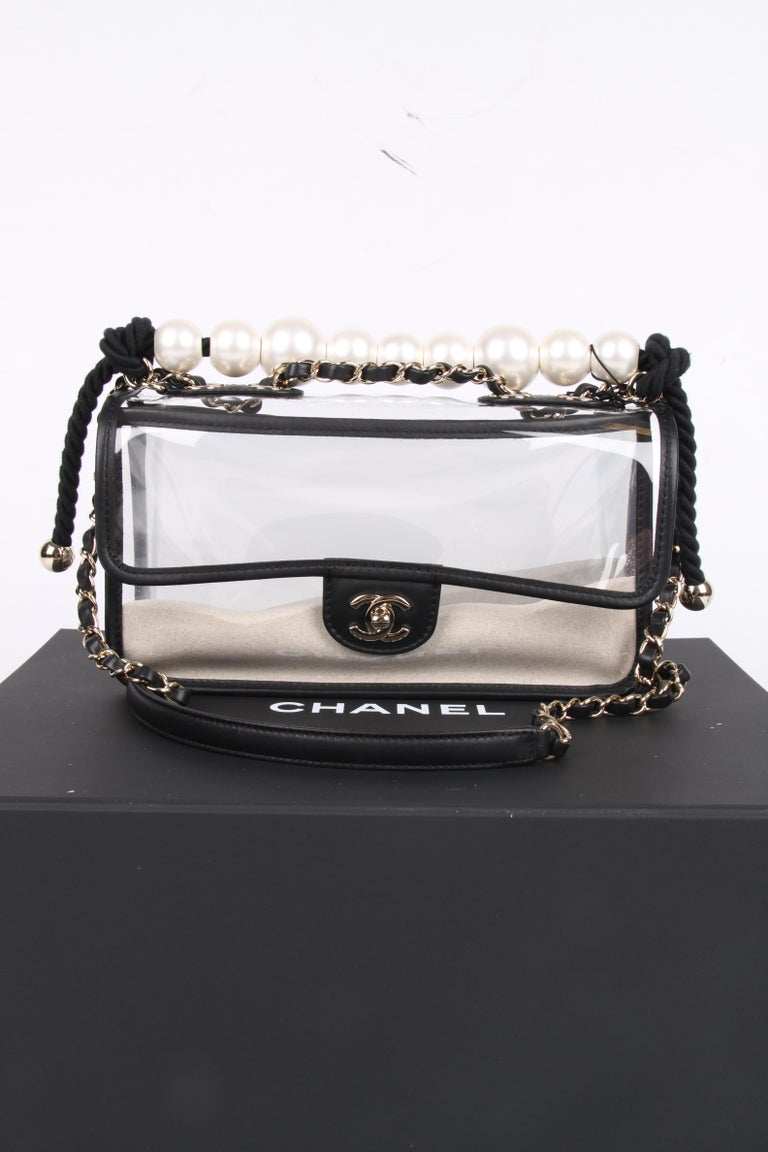 Storefresh! This is a very special item!  A see-through Chanel Flap Bag with a layer of sand on the front and bag. Front closure with a gold-tone CC turnlock.  On top you find a shoulder chain which is entwined with black leather, it can be worn