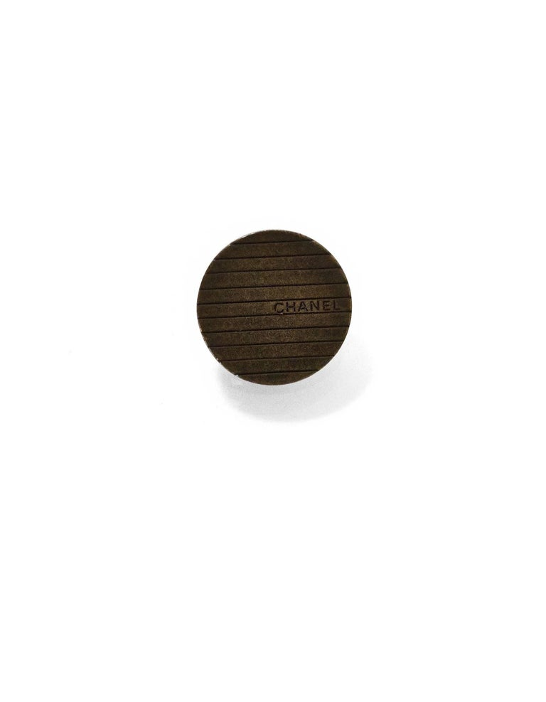 Chanel Brasstone Stripe Buttons Features set of six 18mm buttons  Color: Brass Hardware: Brasstone Materials: Metal Overall Condition: Excellent good pre-owned condition, light surface marks  Measurements:  Diameter: 18mm
