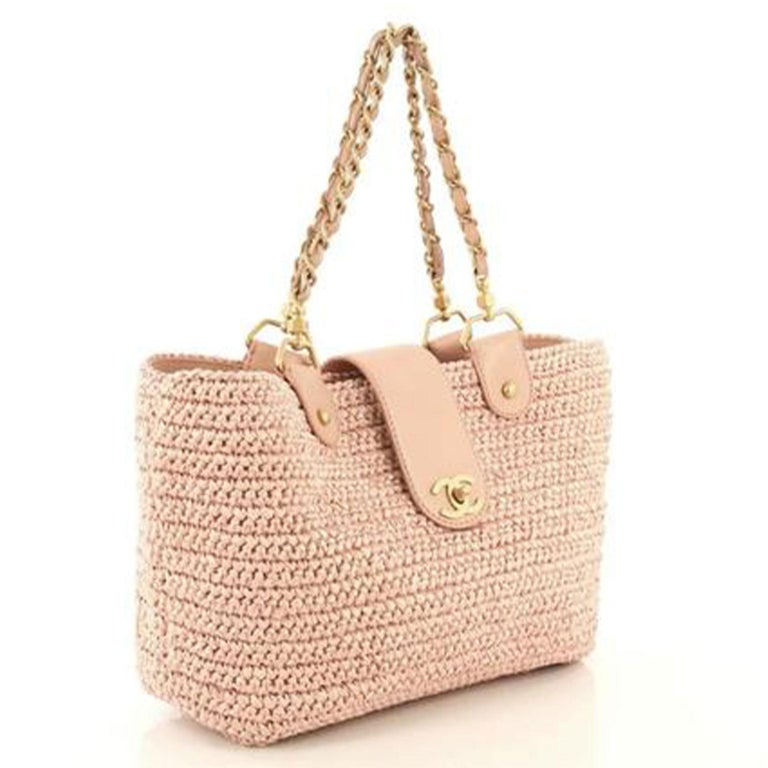 Chanel Organic Raffia Straw Pink Shopping Tote Summer Bag  2005 {VINTAGE 16 Years} Brushed gold hardware Woven pink raffia straw Classic interwoven chain CC Classic Turnlock CC pink logo fabric interior  Interior zippered pocket   Made in Italy