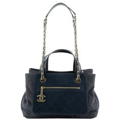 Chanel Shopping Tote Denim with Quilted Aged Calfskin Medium