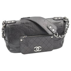 Chanel Shoulder Black Bag in Grained Leather and Silver Hardware.