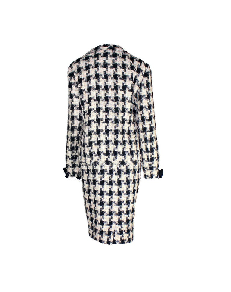 Beautiful CHANEL tweed jacket with matching skirt  Designed by Karl Lagerfeld for Chanel      A true CHANEL signature item that will last you for many years     Both pieces can be worn as a suit or single - always stunning!     Perfect to be