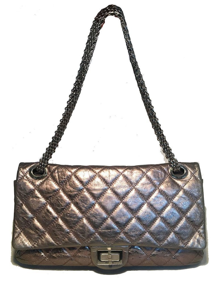 GORGEOUS Chanel Silver Aged Calfskin 2.55 Reissue 227 Double Flap Classic Shoulder Bag in excellent condition.  Gunmetal silver aged calfskin quilted exterior trimmed with silver hardware and mademoiselle twist closure.  Double flap style opening