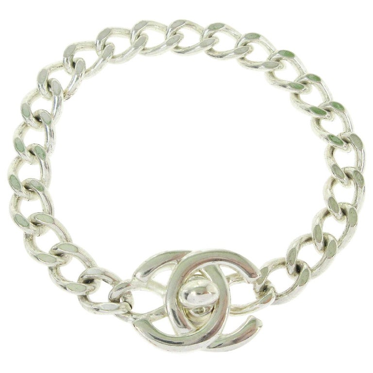 Chanel Silver Chain Link Turnlock Charm Logo Evening Bracelet in Box  For Sale