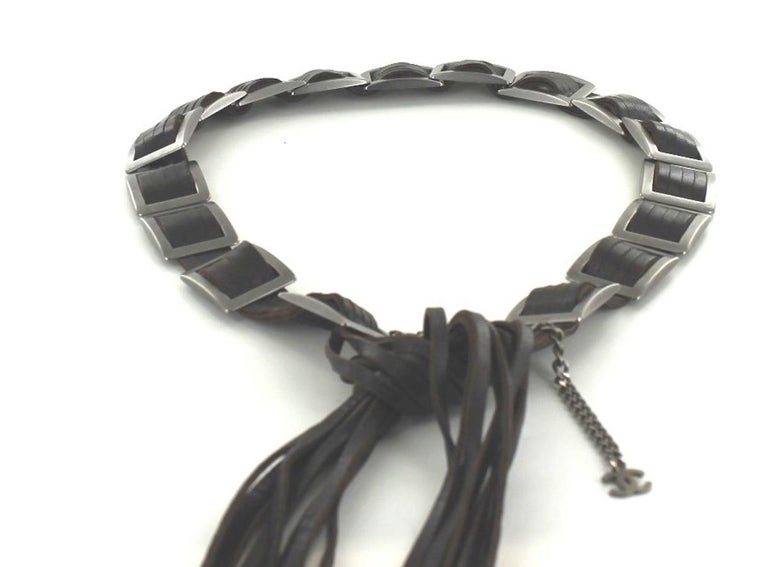 Very beautiful Chanel belt in dark brown leather with square buckles in antique silver metal. Collection cruise 2001. Adjustable length. Aged silver metal pendant CC in the end string. Made in France. Total length: 115 cm Width: 3 cm Will be
