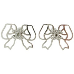 Chanel Silver Metal Logo Charm Rhinestone Bow Evening Stud Earrings