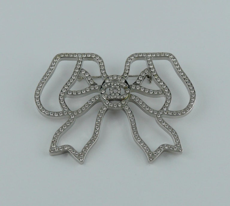Women's Chanel Silver Toned Jewelled Bow Brooch For Sale