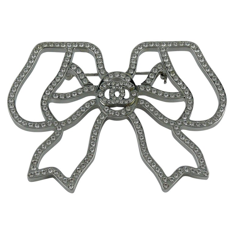 Chanel Silver Toned Jewelled Bow Brooch For Sale