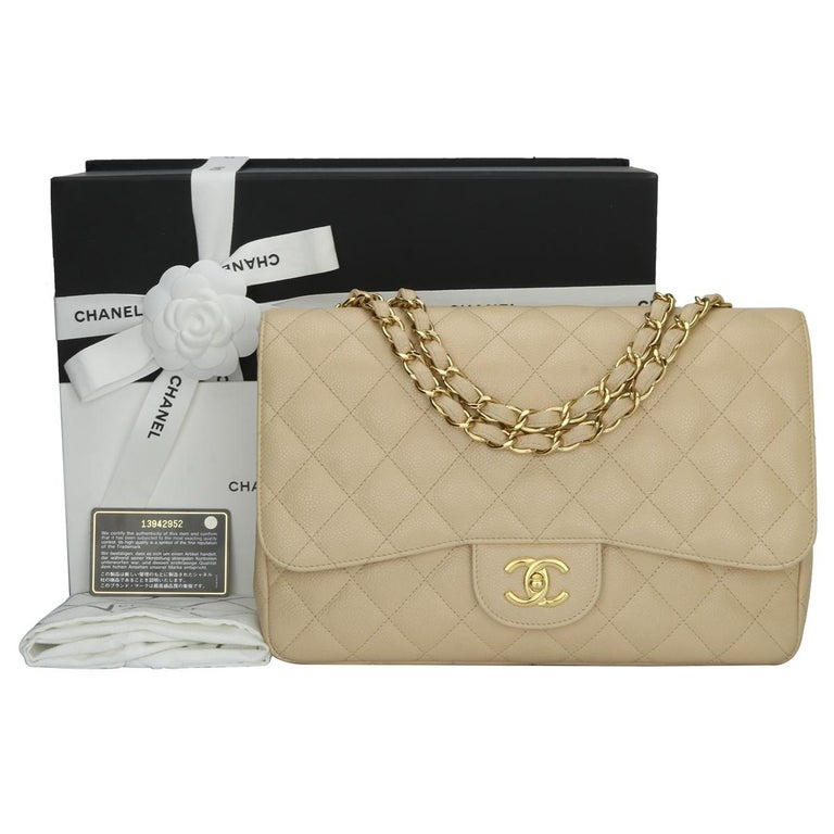 Authentic CHANEL Classic Single Flap Jumbo Bag Beige Clair Caviar with Gold Hardware 2009.  This stunning bag is in mint condition, the bag still holds the original shape and the hardware is still very shiny.  Exterior Condition: Mint condition,