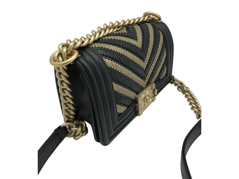 Gorgeous Chanel 2019 Limited Edition Egyptian Small Boy bag for sale. Made from Black and Gold leather in a chevron pattern – just exquisite. This bag is in as new condition.  BRAND Chanel  FEATURES CC Clasp. closure, One interior compartment, One