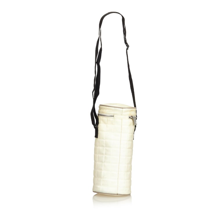 f15b4260671e The Chanel Sport Line crossbody bag is features a quilted white nylon body,  an adjustable. Beige Chanel Sport Line Quilted Nylon Shoulder Bag For Sale