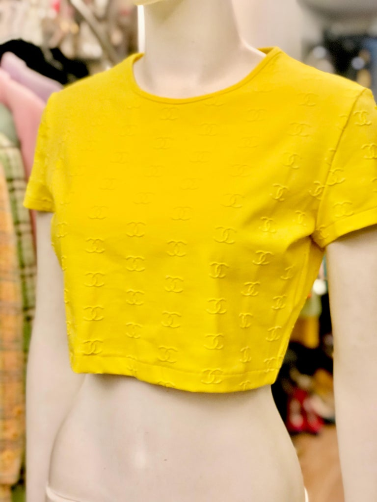 """- Vintage 1997 spring Chanel yellow """"CC"""" cropped top.   - Size 44. (It fits smaller since it stretches.)   -90.1% Nylon. 9.9% Spandex."""