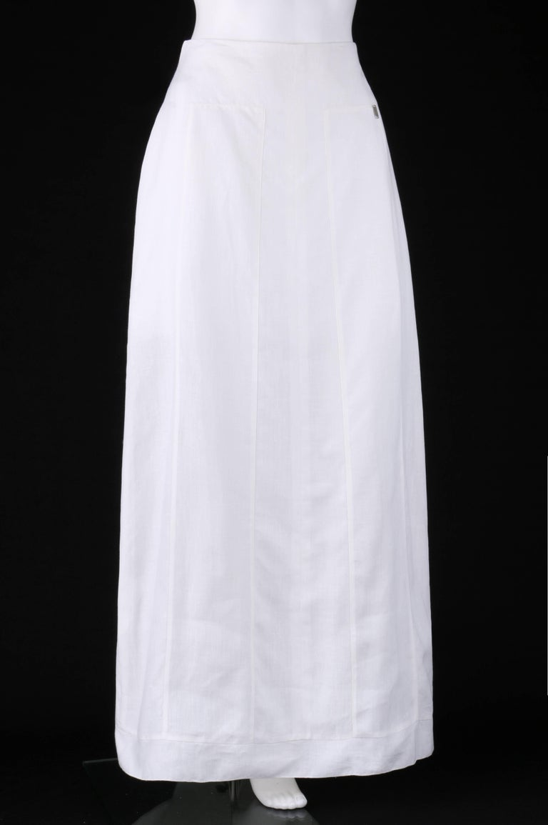 Chanel Spring/Summer 1999 white linen floor length classic maxi skirt; New with tags. Designed by Karl Lagerfeld. Floor length. Maxi style. High waisted. Two inset oblong panels at front and back from hips to hem.