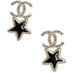 CHANEL Stud Earrings CC with Rhinestones and Glittery Black Resin Star