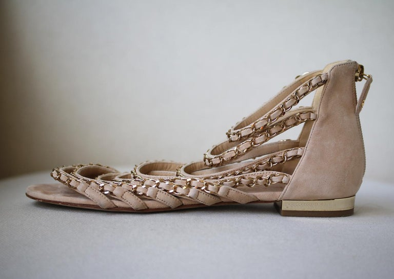 A pair of neutral-hued sandals is a summer essential. With a comfortable, slight heel, Chanel's suede gladiator style has got our vote. Heel measures approximately 7.6 mm/ 0.3 inches. Light-beige suede and gold-tone chains. Structured front straps,
