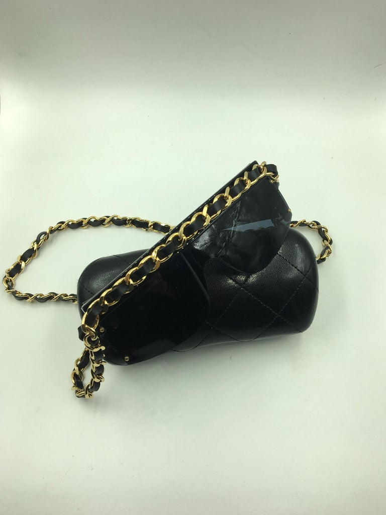 415b956e594e Authentic sunglasses from Chanel with black frames and gold neck strap. The  neck strap runs
