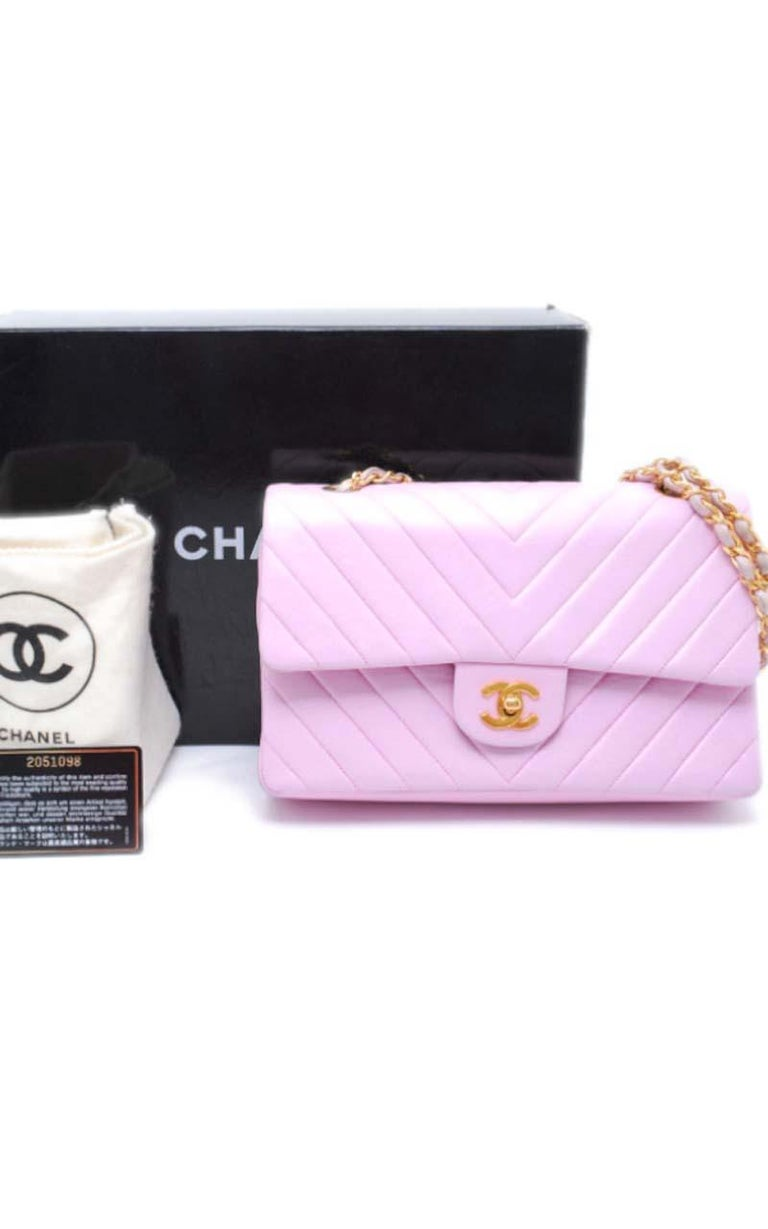Chanel Timeless medium handbag in Baby Pink Leather and gold hardware Pattern : Chevron Dimensions Height: 17cm Depth: 7cm Length: 25cm Place of Origin: France Material Notes :Quilted Lambskin Leather Condition: Good Wear consistent with age and