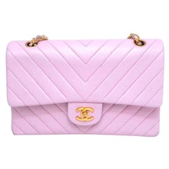 Chanel Timeless Chevron medium handbag in Baby Pink Leather and gold hardware