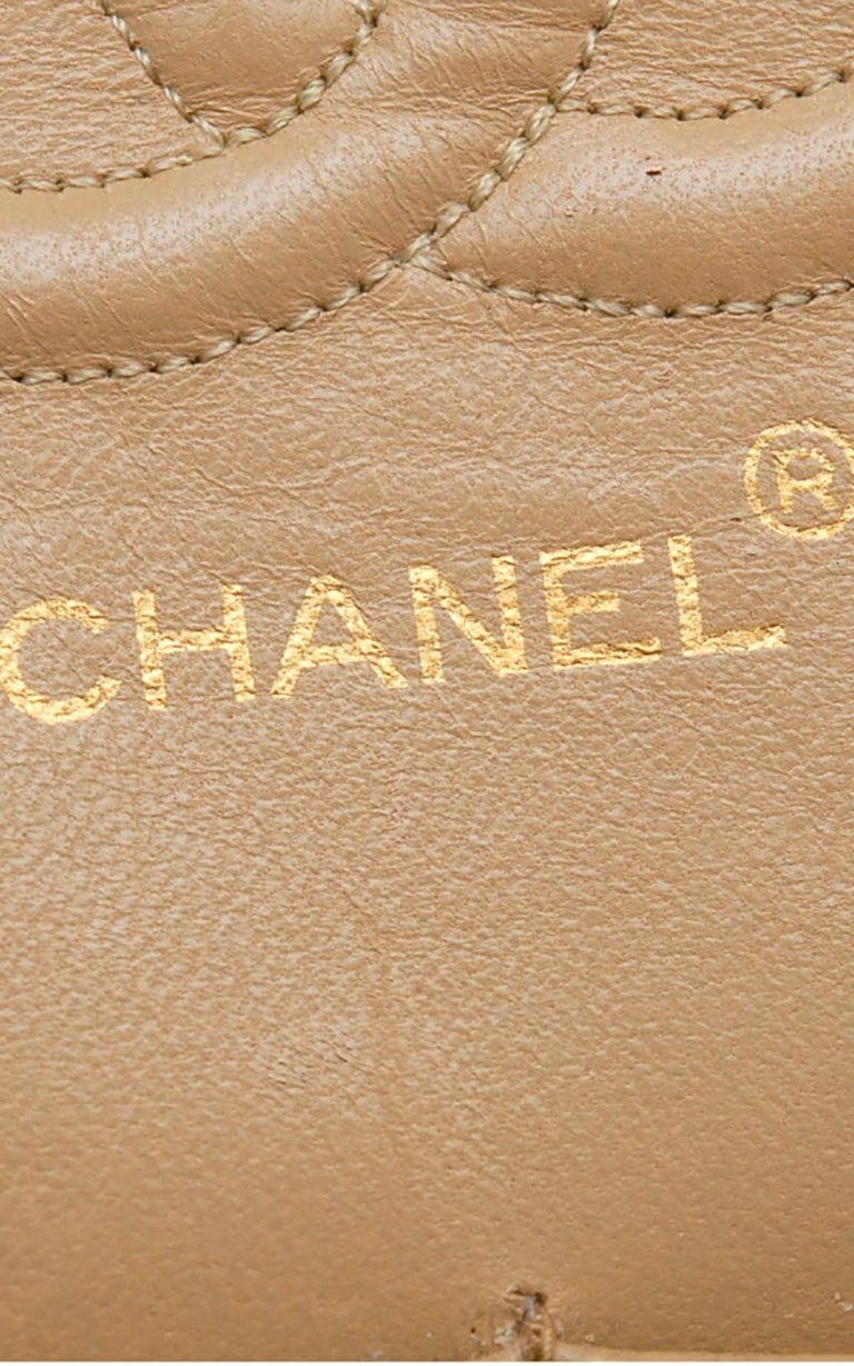 Chanel Timeless handbag in beige quilted leather 6