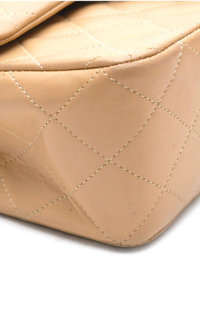 Chanel Timeless handbag in beige quilted leather 1