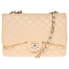 Chanel Timeless Jumbo single flap handbag in beige quilted caviar leather, SHW